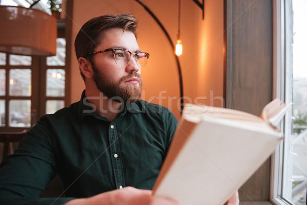 Portret nadenkend bebaarde man boek Stockfoto © deandrobot