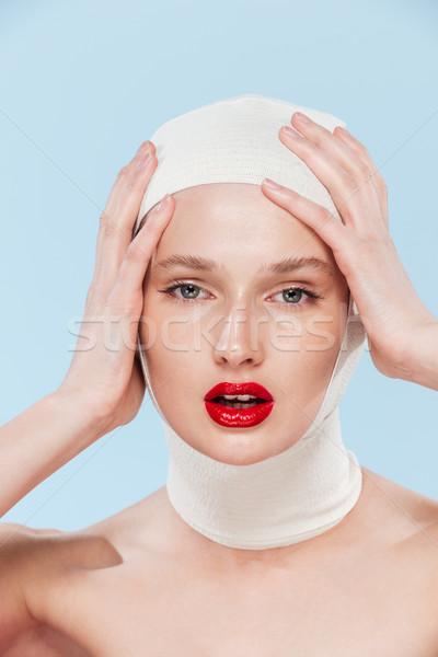 необычный фото женщину глядя камеры изолированный Сток-фото © deandrobot