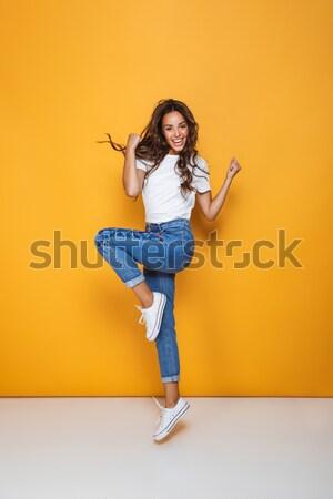 Foto stock: Sorridente · mulher · jovem · saltando · ar · branco · menina