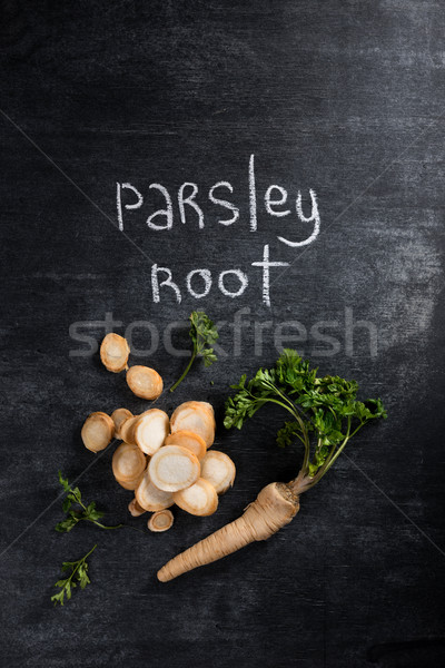 Top view photo of parsley root over dark chalkboard Stock photo © deandrobot