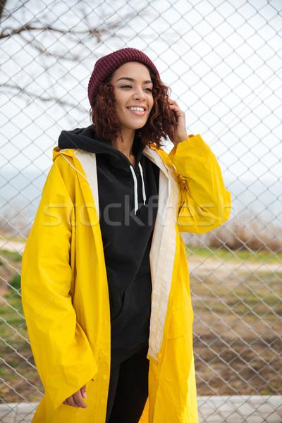 Boldog afrikai fiatal hölgy sétál kint Stock fotó © deandrobot