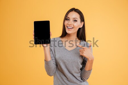 Pregnant happy woman holding ultrasound scans Stock photo © deandrobot