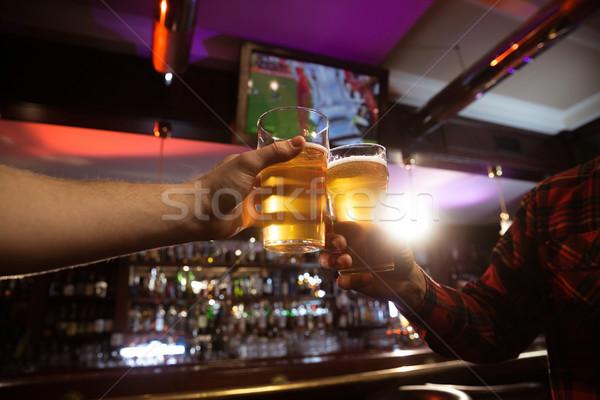 Dois homens cerveja sessão pub Foto stock © deandrobot
