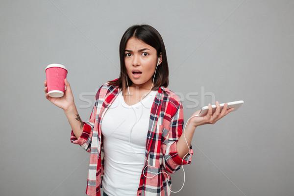 Confusi donna Cup caffè ascolto Foto d'archivio © deandrobot