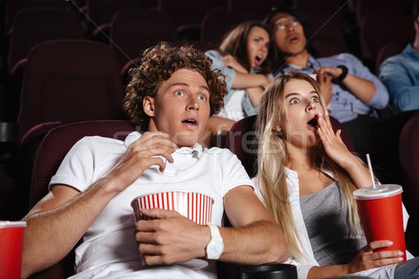 Peur jeunes amis séance cinéma regarder Photo stock © deandrobot