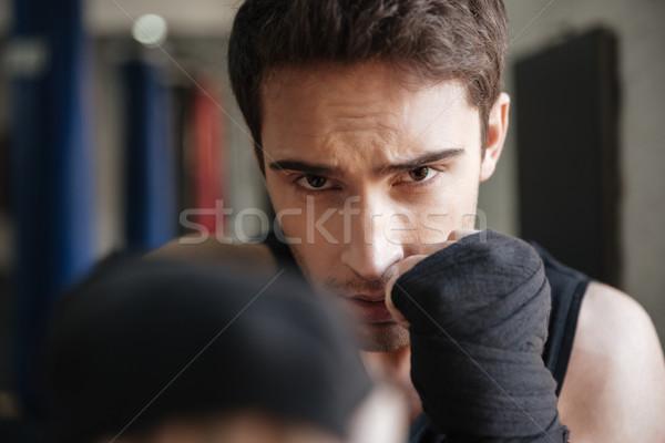 Vista boxeador ejercicio gimnasio mirando Foto stock © deandrobot