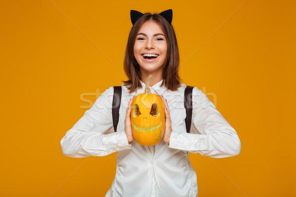 Portrait of a smiling teenage schoolgirl in uniform Stock photo © deandrobot