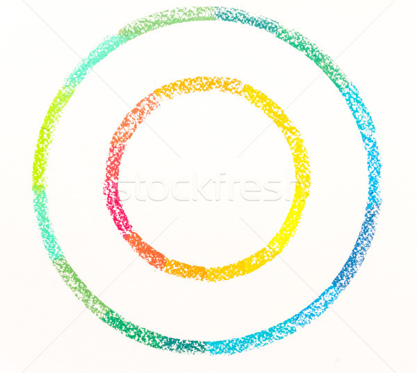 Top view of two circles drawn with colorful pastel chalks  Stock photo © deandrobot
