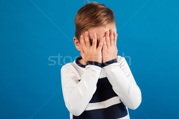 Picture of Young boy in sweater covering his face Stock photo © deandrobot