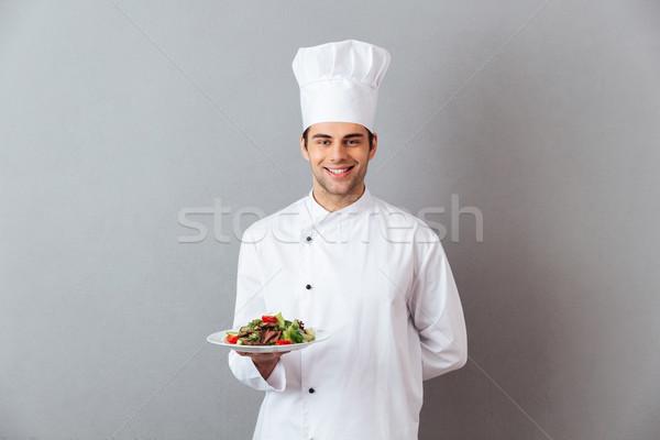 Gelukkig jonge kok uniform salade Stockfoto © deandrobot