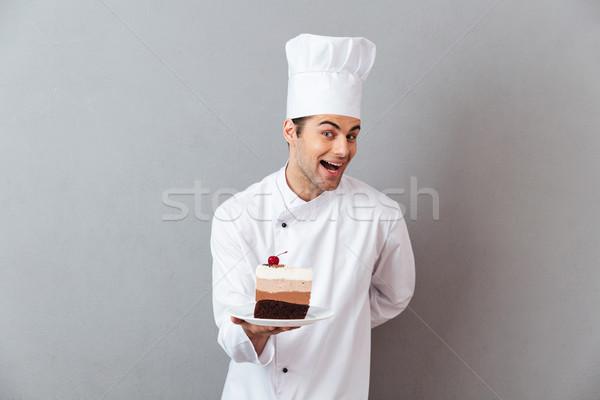 Porträt lächelnd aufgeregt männlich Küchenchef einheitliche Stock foto © deandrobot