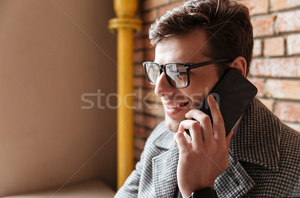 Close up side view of pleased business man in eyeglasses Stock photo © deandrobot