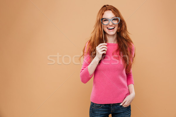 Portrait of a cheery young redhead girl Stock photo © deandrobot