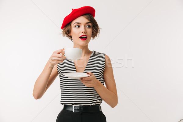 Retrato mulher vermelho boina potável Foto stock © deandrobot