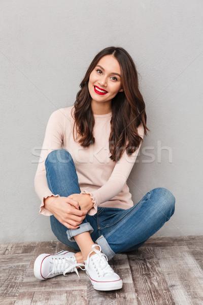Nő piros ajkak lezser ruházat ül lótusz Stock fotó © deandrobot