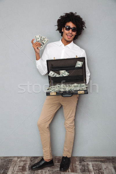 Full length portrait of a happy excited afro american man Stock photo © deandrobot