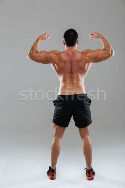 вид сзади портрет сильный мужчины Культурист Сток-фото © deandrobot