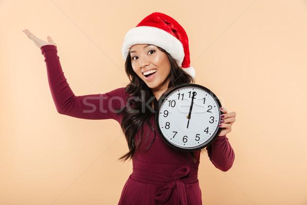Portrait of a happy asian woman Stock photo © deandrobot