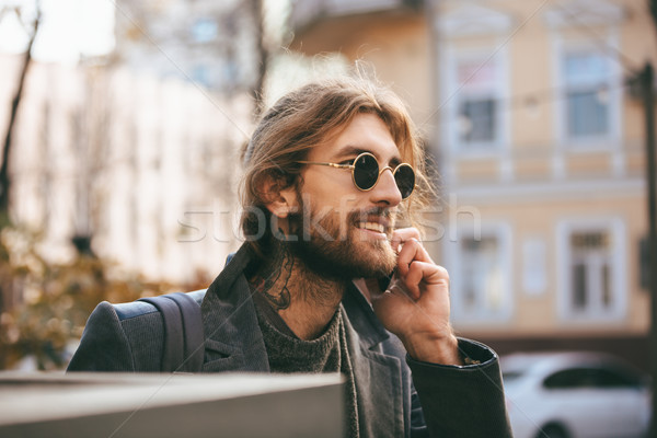 Portrait of a smiling bearded man in sunglasses Stock photo © deandrobot