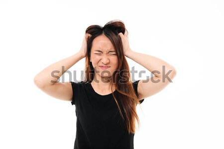Close-up portrait of annoyed asian woman with closed eyes holdin Stock photo © deandrobot
