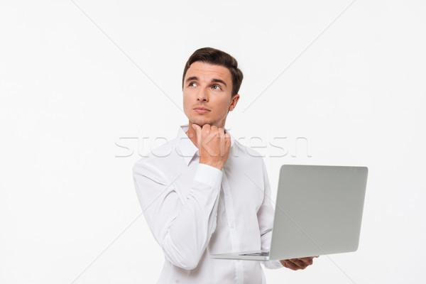 Portret zamyślony zamyślony człowiek biały shirt Zdjęcia stock © deandrobot