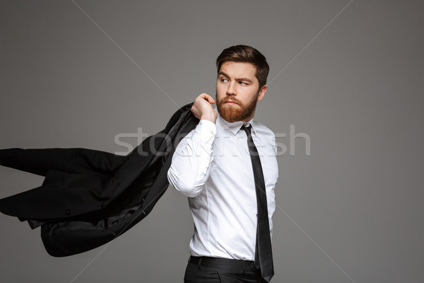 Portrait jeunes affaires posant veste épaule Photo stock © deandrobot