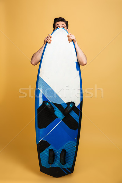 Full length portrait of a scraed young man Stock photo © deandrobot