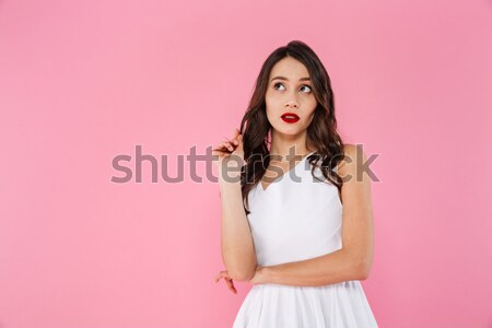 Shocked sportswoman holding smartphone and looking at the camera Stock photo © deandrobot