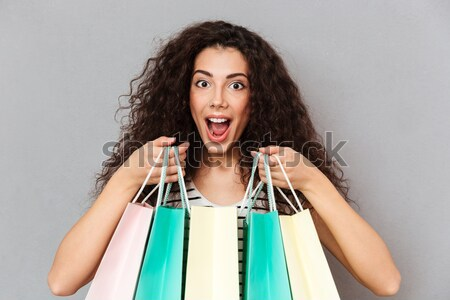Surprised excited young pretty woman shopaholic Stock photo © deandrobot
