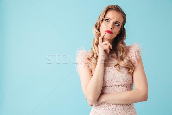 Zamyślony sukienka dotknąć podbródek Zdjęcia stock © deandrobot