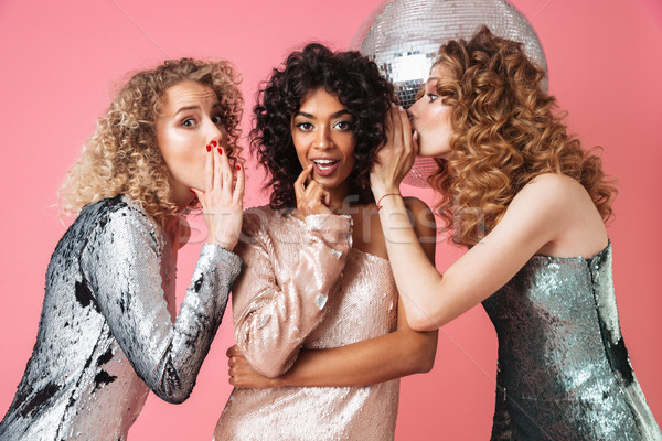 Three beautiful young women in shiny dresses Stock photo © deandrobot