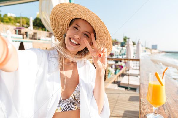 фото очаровательный женщину 20-х годов соломенной шляпе Сток-фото © deandrobot