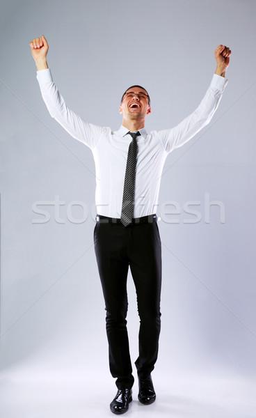 Portrait heureux affaires mains up Photo stock © deandrobot