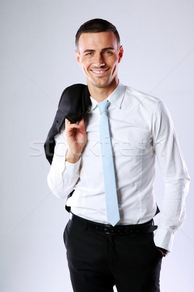 Mutlu iş adamı ceket omuz gri Stok fotoğraf © deandrobot