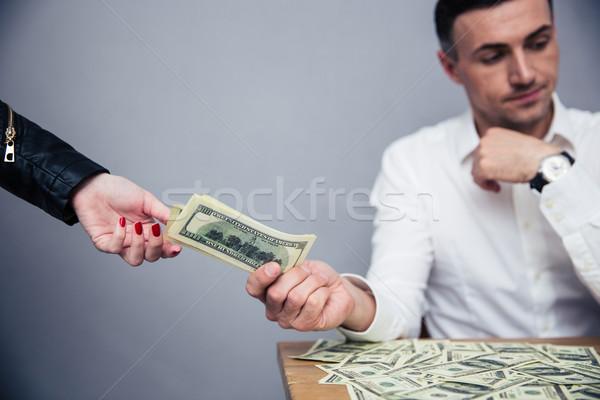 Boldogtalan férfi pénz nő szürke kéz Stock fotó © deandrobot