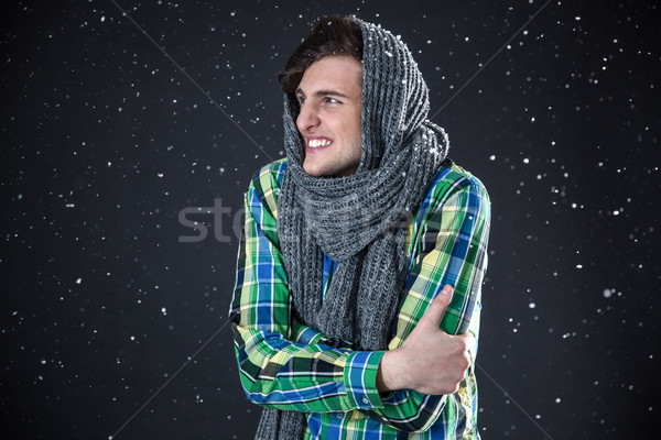 Happy man standing with snow on background Stock photo © deandrobot