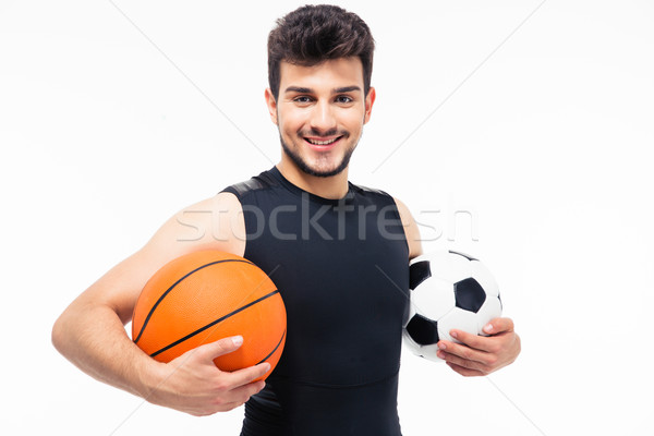 Sports man holding basketball and soccer ball Stock photo © deandrobot