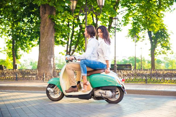 Boldog pár lovaglás moped kint lány Stock fotó © deandrobot