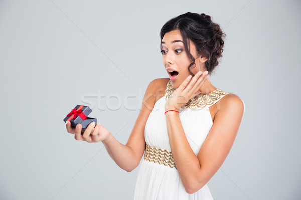 Woman opening jewelry gift box Stock photo © deandrobot