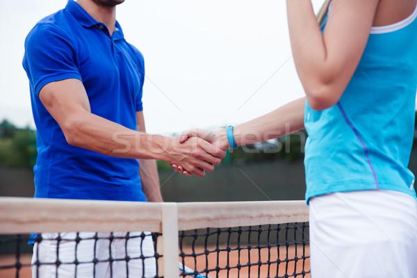Closeup portrait of a man and woman handshaking Stock photo © deandrobot