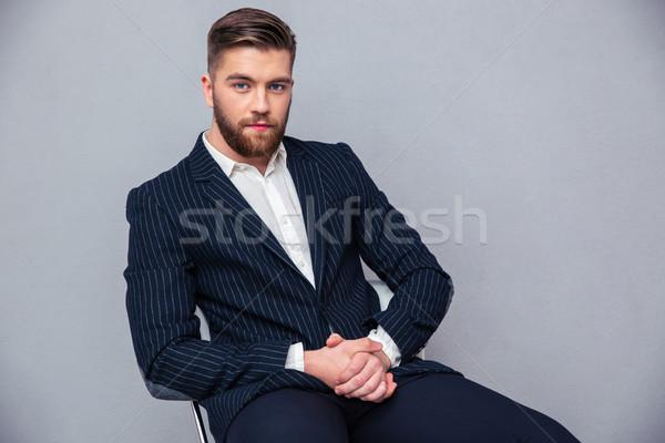 ビジネスマン 座って 事務椅子 肖像 ハンサム グレー ストックフォト © deandrobot