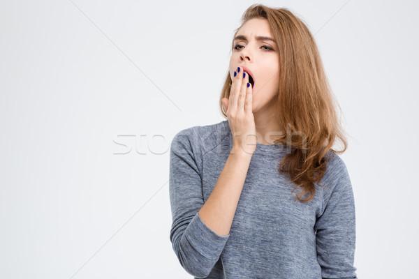 Portré fiatal nő ásít izolált fehér nő Stock fotó © deandrobot