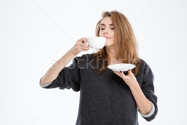 Beautiful woman smelling cup with coffee Stock photo © deandrobot