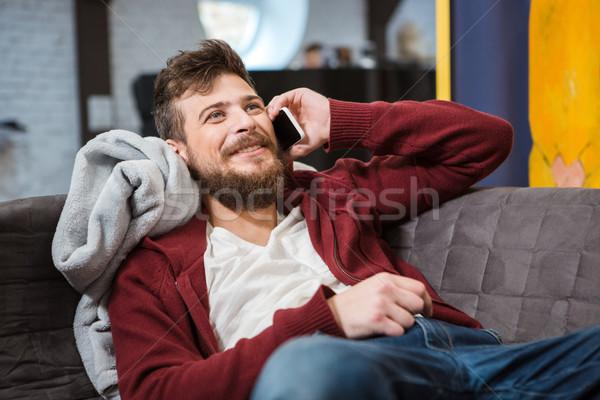 笑みを浮かべて 話し 携帯電話 幸せ ハンサム ストックフォト © deandrobot
