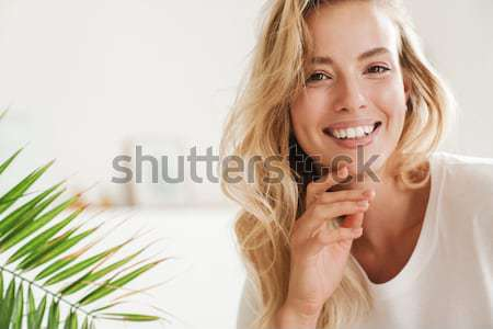 Happy thoughtful redhead woman in bathrobe Stock photo © deandrobot