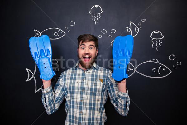 Stock fotó: Izgatott · férfi · kezek · áll · iskolatábla · szórakoztató