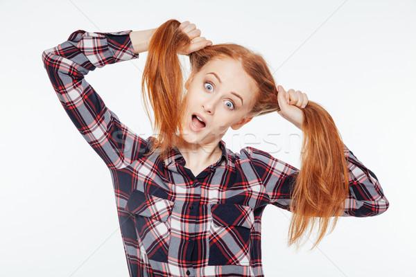 Vörös hajú nő nő tart vicces izolált fehér Stock fotó © deandrobot