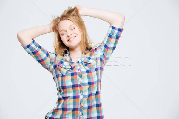 Smiling young woman with closed eyes Stock photo © deandrobot