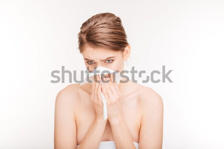 Unhappy young woman catched a cold and using paper handkerchief  Stock photo © deandrobot