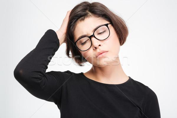 Szomorú nő izolált áll fehér szemek Stock fotó © deandrobot
